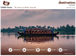 Houseboat in backwaters near palms at cloudy blue sky in Allapuzha, Kerala, Indi