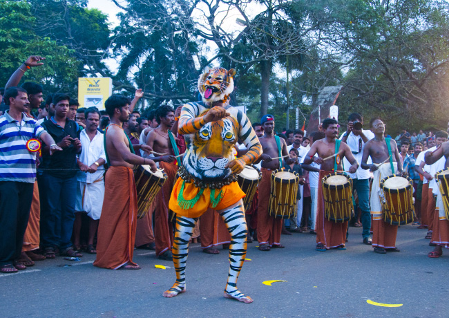 Man Performing during Onam
